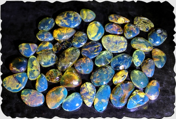 Wholesale lot, 43 Dominican Clear Sky Blue Amber polished Cabochons biggest  20mm  19.2g