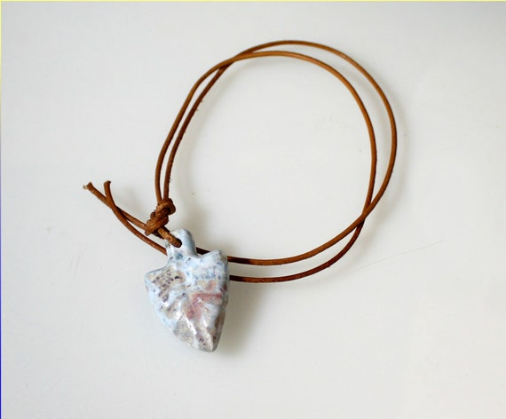 Charming Design Natural Light Blue Arrow Point Carving Larimar Leather Necklace looks like 10.000 years old cavemen work