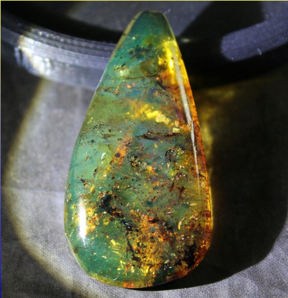 Dominican Natural Translucent Cognac Blue Green Amber Polished Stone Pendant 48x25x9mm 5.8g