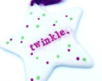 "Porcelain ""twinkle"" star ornament"