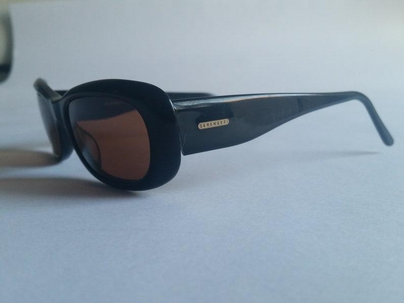 8128563c023b Vintage Serengeti Sunglasses Black Used   Etsy