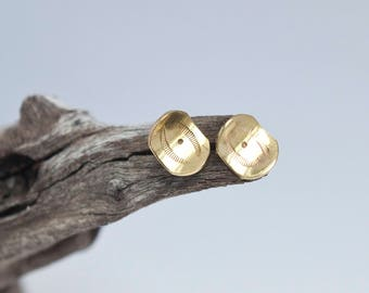 Small curved golden stud earrings in brass (silver ear post) •  southwest patterns
