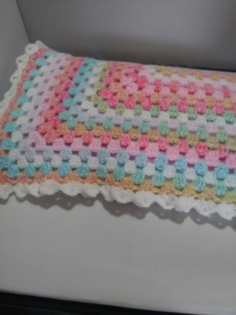 Hand crochet Baby pram blanket made in uk two sizes hats unisex colours White shell edge with two hats babies shawl variagated yarn