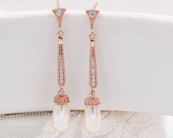 Rose gold or silver slim pearl drop earrings, with Swarovski pearls or crystals. Encrusted with cubic zirconia.