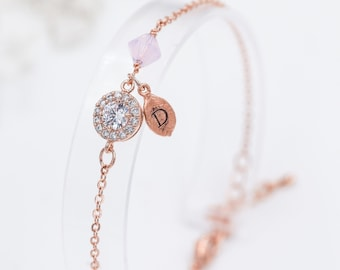 Personalised Crystal bracelet, finished in  rose gold or silver, with tiny leaf  Initial charm, cubic zirconia.