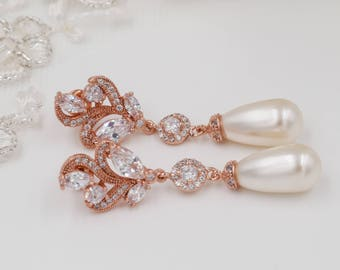 Bridal pearl drop earrings or pendant set, with matching bracelet, with leaf flower designs and Swarovski pearls