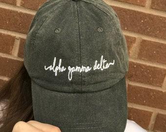 f9590fe90dd14 ALPHA GAMMA DELTA Handwriting script baseball cap - Officially Licensed  Greek Baseball Hat