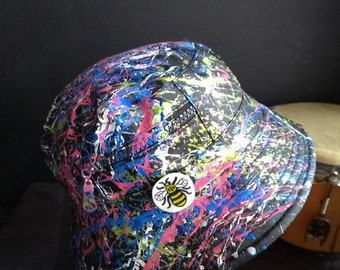Hand painted wearable abstract art on a shower proof bucket with a hand  crafted polymer clay Manchester Worker Bee inspired by The Roses f5053ef2dd71