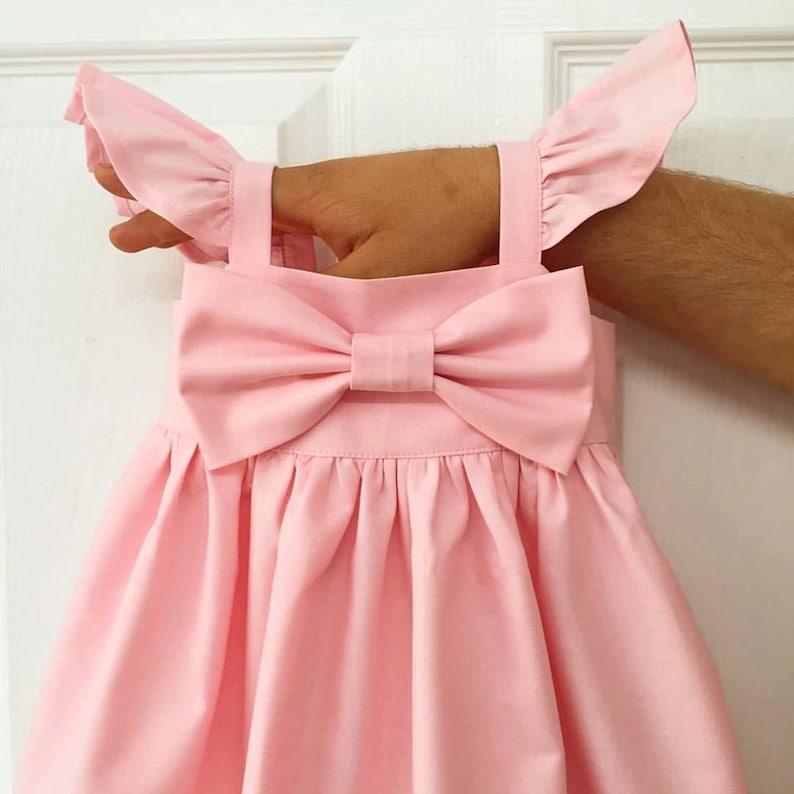 b7075b86ef73a Manches bouffantes roses bébés Big bow robe robe de nœud