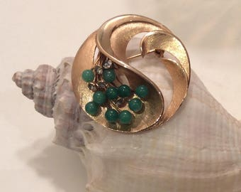 Gold tone Brooch with Green Accents and prong set Rhinestones