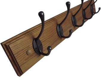 Wooden coat rack in solid oak with cast iron hooks
