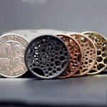 Tíu Hringpoki Krónur- a fidget coin for the artistically minded