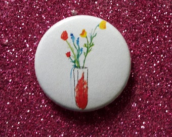 badge/pin tampon and flowers, feminism