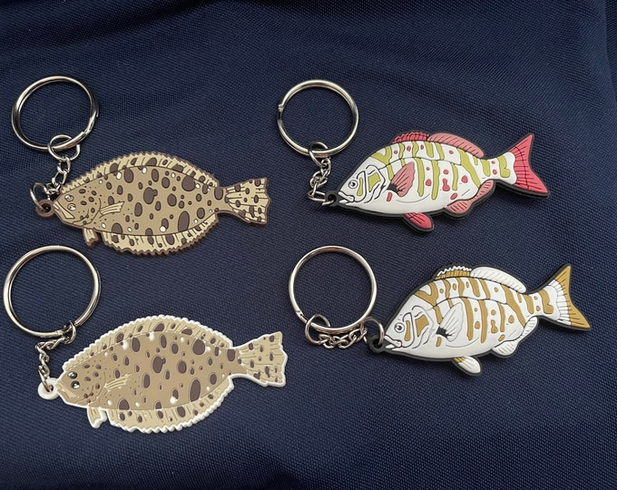 Choice of Deluxe pvc barred surf perch 3D two sided glow in the dark keychain. 3 inches. And deluxe red tail perch non glowLimited supplies.
