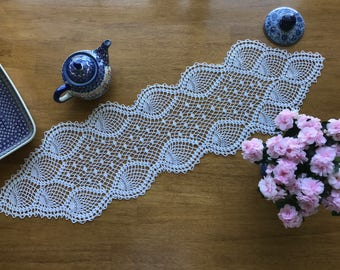 Lace Crocheted path on the table. Decoration for a cozy home. A gift for her.
