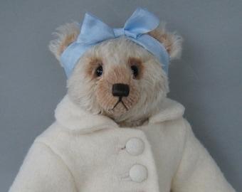 Hanna, a 28 cm creme colored long curly mohair teddy bear