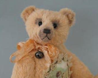 Jessy, a 19 cm pink viscose Teddy Bear