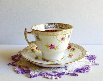 Vintage Phoenix TF & S Ltd Teacup and Saucer, England. Pink and Purple Floral Garlands with Greenery, Gold Border, Asian Style Handle