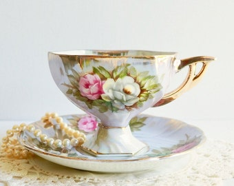 Vintage Japanese Pedestal Lusterware/Iridescent Teacup & Saucer with Pink and White Roses on a Pastel Blue Background. Vintage Tea Party