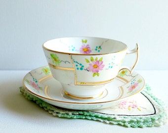 Vintage Phoenix T. F. & S. Ltd. Teacup and Saucer, England. Pink, Green and Blue Floral Garlands, Gold Abstract Trim, Asian-Style Handle