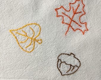 Flour sack towel, hand embroidered: Autumn leaves