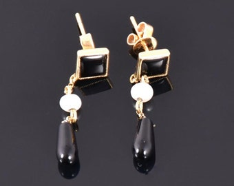 A Pair Of Onyx and Pearl Earrings