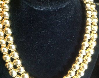 Vintage Signed Trafira gold tone necklace in polished bright beads