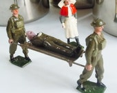 Vintage Britains Toy Soldiers Wounded Soldier on a stretcher, Nurse and 2 attendents Trench Warfare
