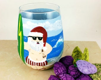 Hand painted glass, Christmas glasses, surfing Santa, Santa wine glass, Ocean lover gift, Painted drinking glasses, Santa milk glass