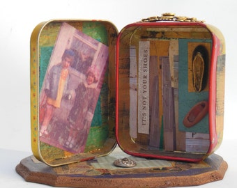It's Not your Shoes: Assemblage piece made with metal tin, photos and vintage found objects.