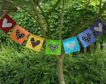Prayer flags fabric, handmade banner in rainbow and chakra colors, hearts in black and white