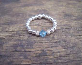925 Sterling Silver Elasticated Ring with Light Sapphire Swarovski Crystal