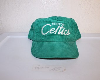 sports shoes b99da c54c1 Vintage 90 s Boston Celtics Zipperback Hat by Sports Specialties
