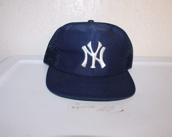 931a9510e42 Vintage 90 s New York Yankees Meshback Snapback by Universal