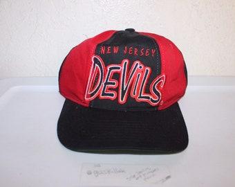 quality design 26bba f176c Vintage 90 s New Jersey Devils Snapback Hat by Starter