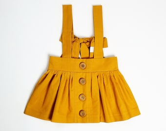 Mustard Bow Back Suspender Skirt (6M-14Yrs) Mustard Yellow. Button Down. Fall, Winter, Spring, Summer