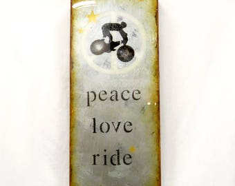 """Antique Silver """"Peace Love Ride"""" - Trail Bicycle Rider Gift, MountainBiker/, hand paint'd,high gloss resin, on light hollow wooden cradle."""
