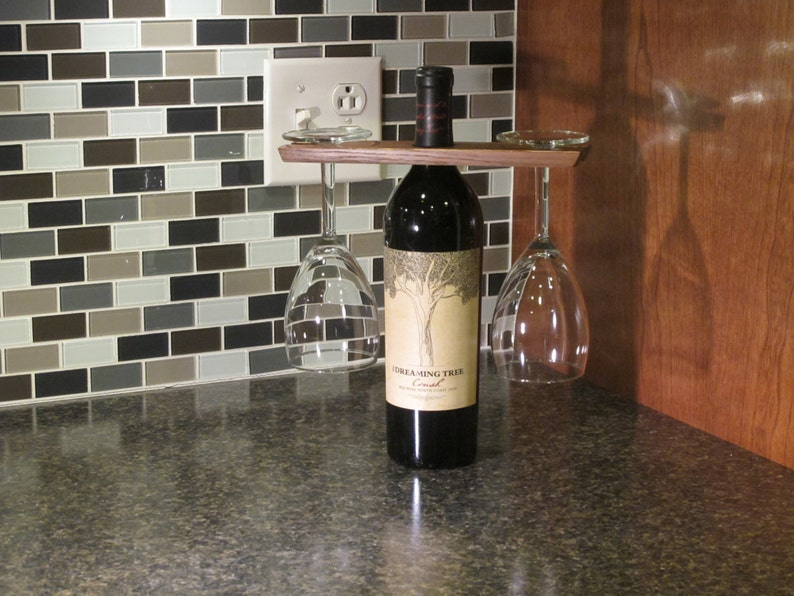 Wine glass hanger and bottle display.  Wine table setting. image 0