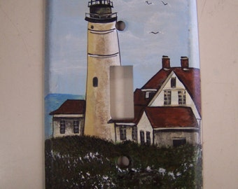 Metal single light switch cover with a lighthouse