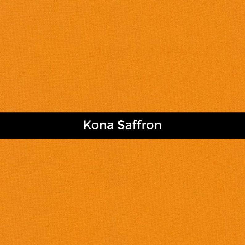Priced by the Half Yard Kona Saffron