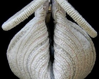 Beautiful white beaded clutch purse.