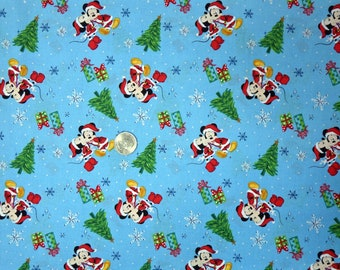 springs creative mickey and minnie christmas love 18002 disney mickey and minnie mouse kissing on blue one yard of fabric - Disney Christmas Fabric