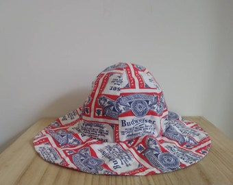 68f960a0baf vintage 70s Budweiser hat   Budweiser beer add print   70s Beach bum sun hat    vintage bucket hat   all over print   CarnivalofFashion