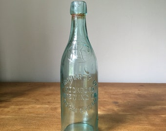 Vintage pre-prohibition blue glass beer bottle from Rockford Brewing company 1900-1920 era