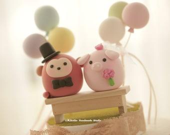 pig and monkey wedding cake topper