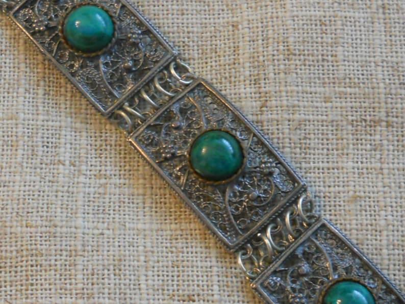 Vintage filigree bracelet with green stones