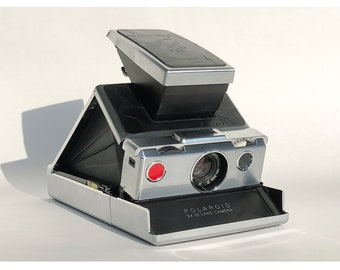 Rare Polaroid SX-70 BAPE edition mint condition refurnished by impossible project