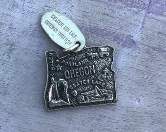 Sterling Silver Oregon State Charm Pendant, 3.3g.Salem, Portland, Crater Lake, Canoe, Wagon, River, Stamped Crescent City Comeback Town CA