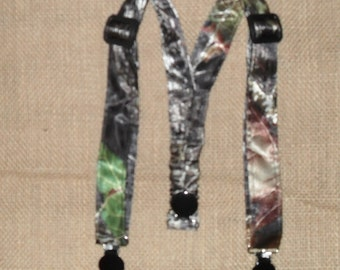 Camo Kids Suspenders.Made with Mossy Oak Break up Satin Camo.Great for Weddings,Easter or anytime.Choose size from the select options below.