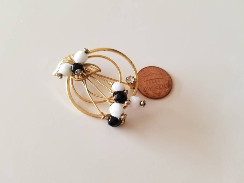 Gold Tone vintage Circle BroochPin with crystals and black and white beads